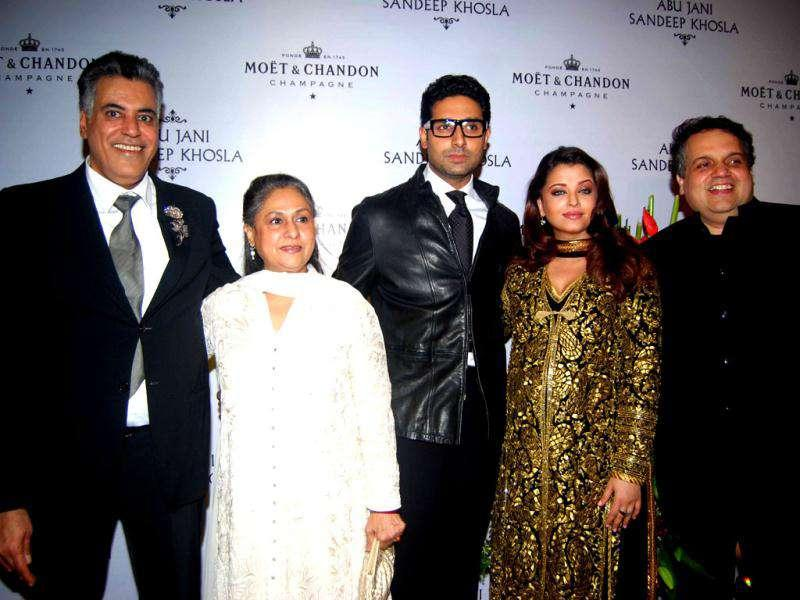 The couple poses with Jaya Bachchan and designer duo.