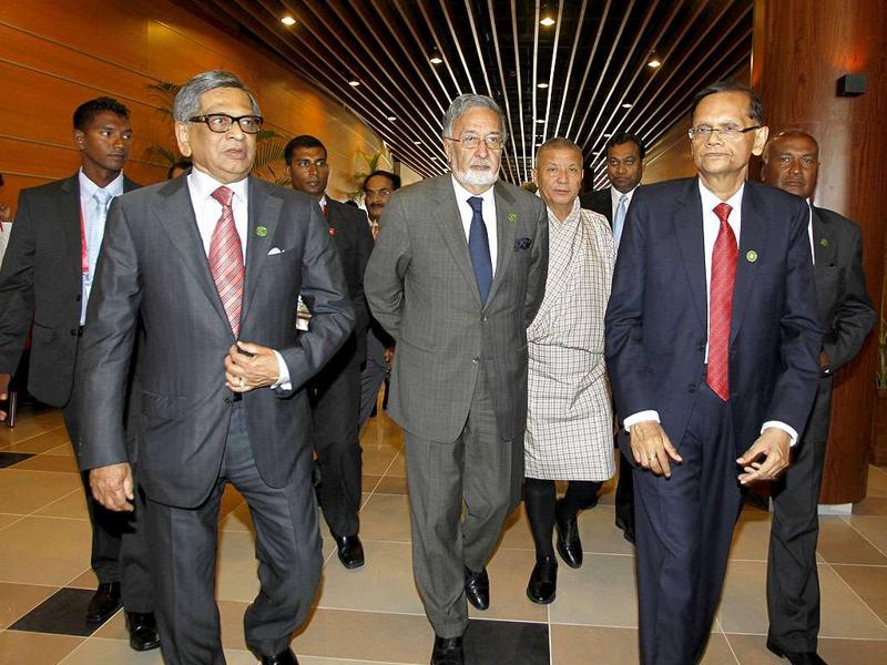 Foreign ministers from left, India's SM Krishna, Afghanistan's Zalmai Rassoul, Bhutan's Lyonpo Ugyen Tshering, and Sri Lanka's Gamini Peiris, arrive for the South Asian Association for Regional Cooperation (SAARC) foreign ministers meeting in Addu, Maldives, Wednesday.