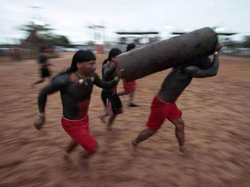 Xavantes Indians race with a tree trunk during the Indigenous Games on the island of Porto Real in the city of Porto Nacional, Brazil.