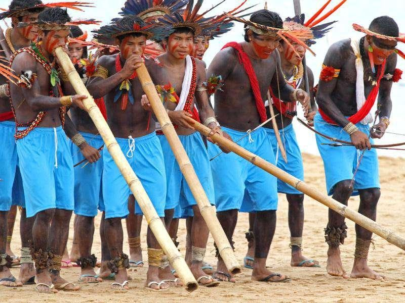Assurini Indians perform a sacred dance with traditional flutes during the Indigenous Games on the island of Porto Real in the city of Porto Nacional, Brazil.