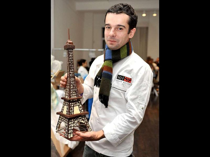 Sofitel Washington DC hotel French Pastry Chef Vincent Bitauld holds his chocolate Eiffel Tower creation during the opening night of the New York Chocolate Show on in New York.