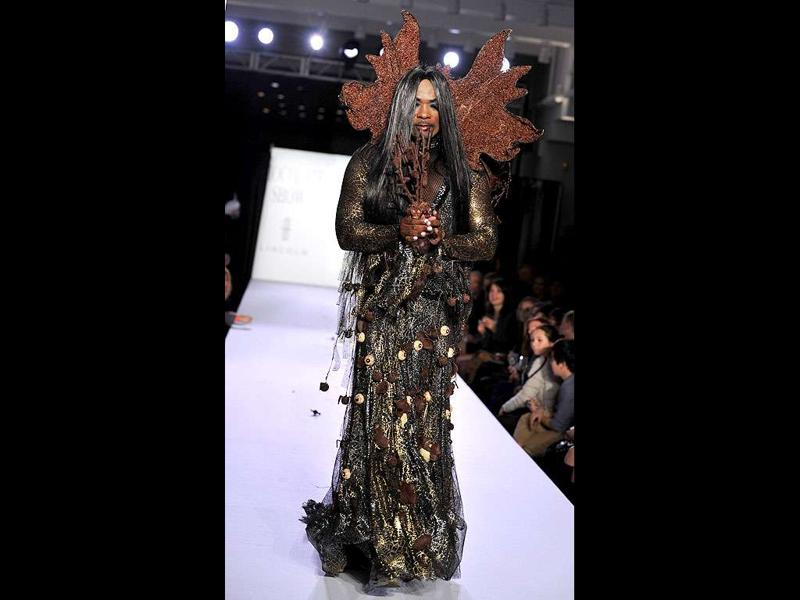 A model displays an outfit decorated with chocolates during the opening night of the New York Chocolate Show in New York.