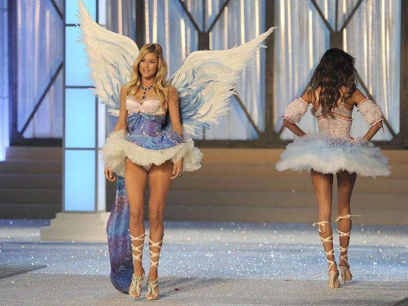 Doutzen Kroes looks like an angel as the wings complement her lingerie. (AFP)
