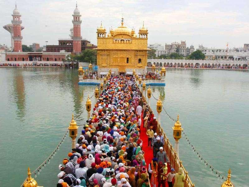The devotees standing in queues to pay obeisance at the Sanctum Sanctorum of Harmandar Sahib on the occasion of birth anniversary Guru Nanak Devji in Amritsar.