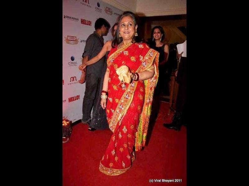 Jaya Bachchan looks not so great in a bright red sari.