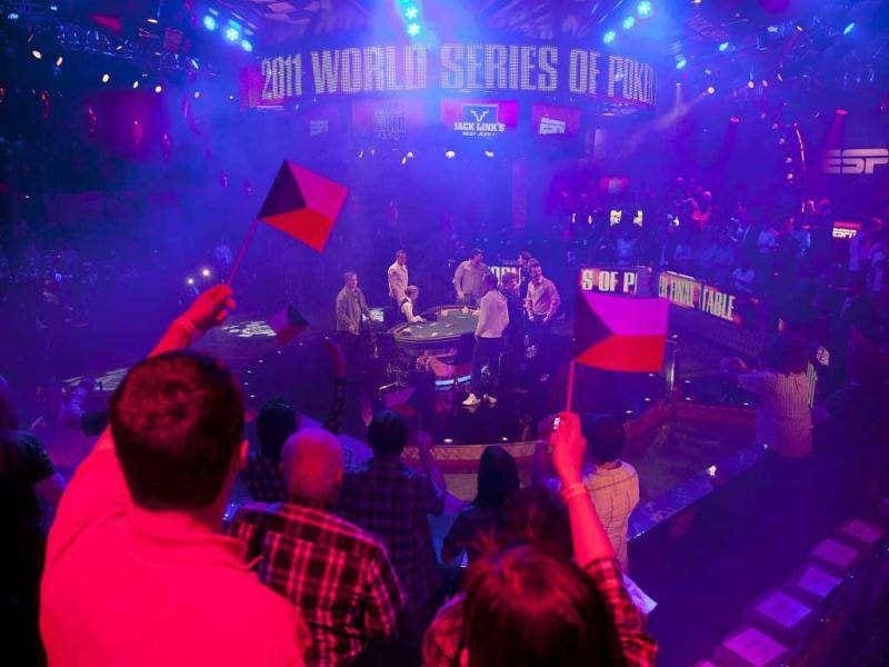 Fans cheer as the nine players arrive to compete in the final table of the World Series of Poker in Las Vegas. (AP Photo/Julie Jacobson)