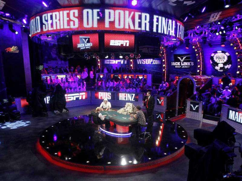 Players compete at the final table of the World Series of Poker in Las Vegas. (AP Photo/Isaac Brekken)