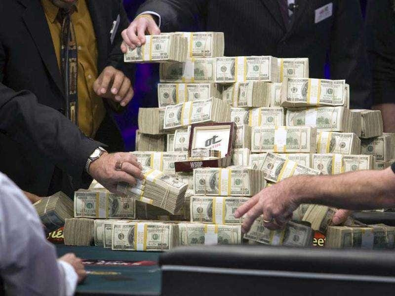 Stacks of cash and the World Series of Poker championship bracelet are placed on a table after Germany's Pius Heinz and the Czech Republic's Martin Staszko emerged as finalists during the WSOP main event at the Rio All-Suite Hotel and Casino in Las Vegas. (Reuters)