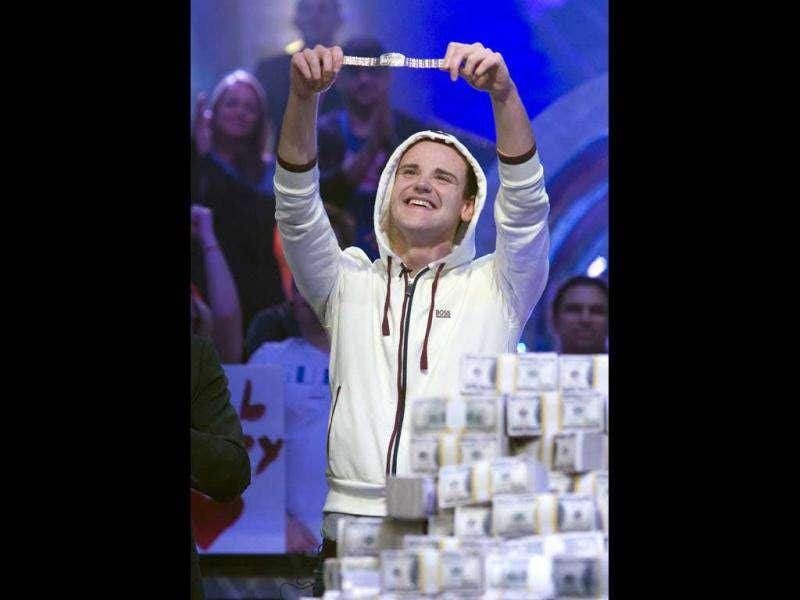 Pius Heinz of Germany holds up his champion after beating Martin Staszko of the Czech Republic to win the bracelet and $8.7 million in prize money during the World Series of Poker main event at the Rio hotel-casino in Las Vegas. (Reuters)