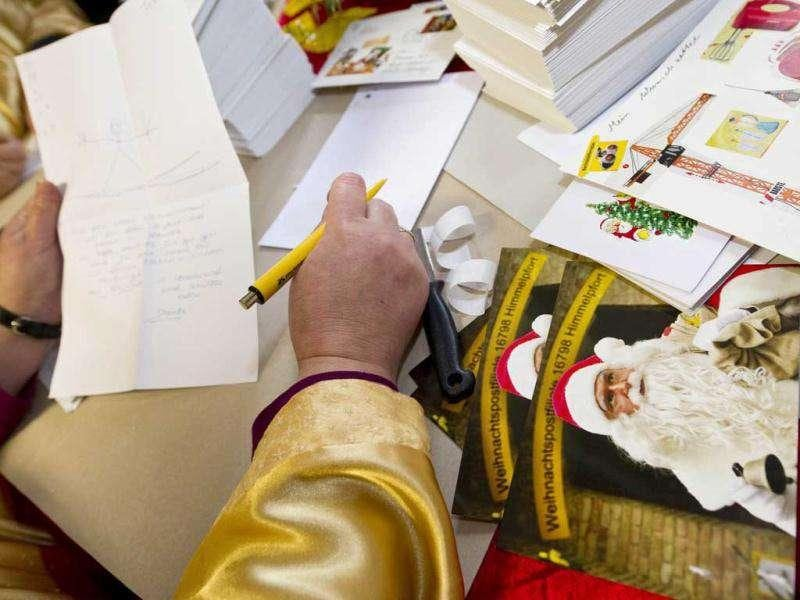 'Santa's helpers' answer children's letters in the Santa Claus post office in the Eastern German town of Himmelpfort (Heaven's Gate). Children can send their Christmas wish lists to Himmelpfort from around the world and receive a reply from Santa. AFP Photo / John Macdougall