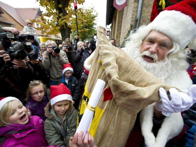 A man dressed up as Santa Claus prepares to give out gifts to local children as he arrives at the Santa Claus post office in the Eastern German town of Himmelpfort (Heaven's Gate). Children can send their Christmas wish lists to Himmelpfort from around the world and receive a reply from Santa. AFP Photo / John Macdougall