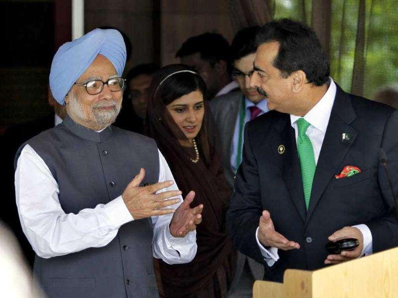 Pakistani Prime Minister Yousuf Raza Gilani, right, and Prime Minister Manmohan Singh gesture after their meeting on the sidelines of the South Asian Association for Regional Cooperation (SAARC) summit in Addu, Maldives.