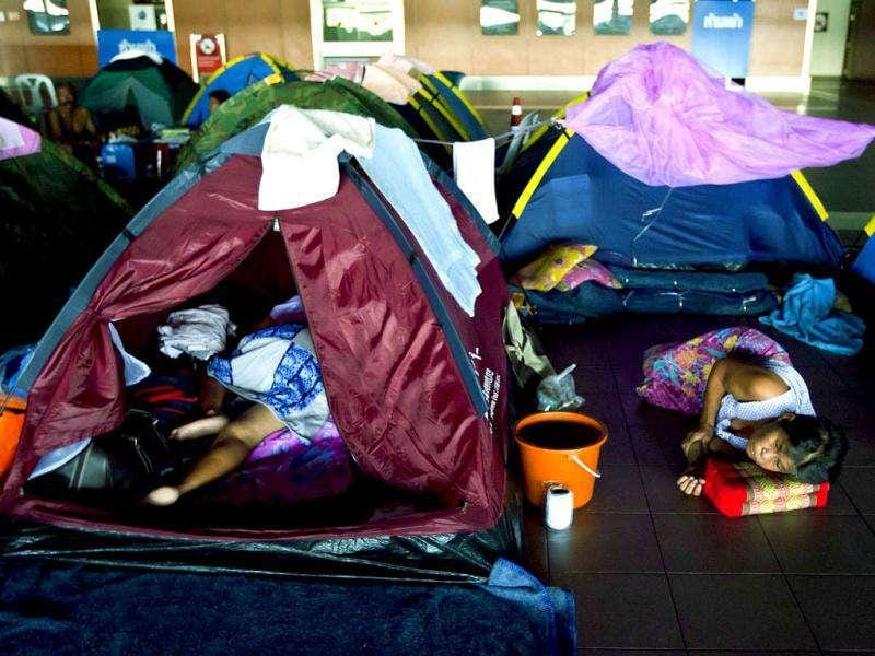People sleep in tents at a flooding shelter at Don Muang Airport in Bangkok. AFP