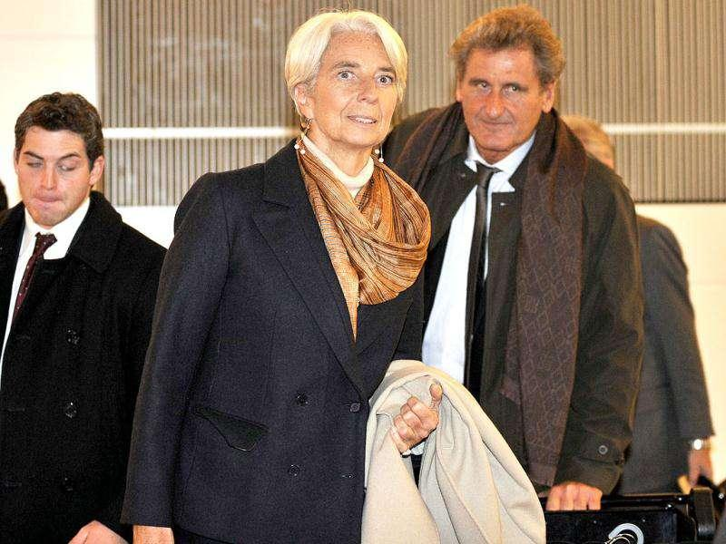 International Monetary Fund (IMF) Managing Director Christine Lagarde (C) arrives at Tokyo's Haneda Airport from Beijing. AFP