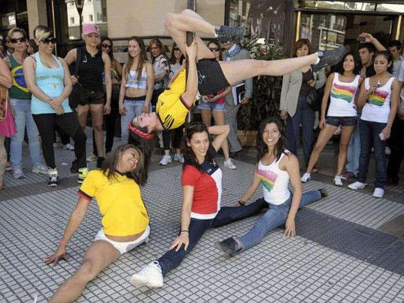South American participants in the Miss Pole Dance Argentina 2011 and Miss Pole Dance South America 2011 competitions pose in downtown Buenos Aires in Buenos Aires.