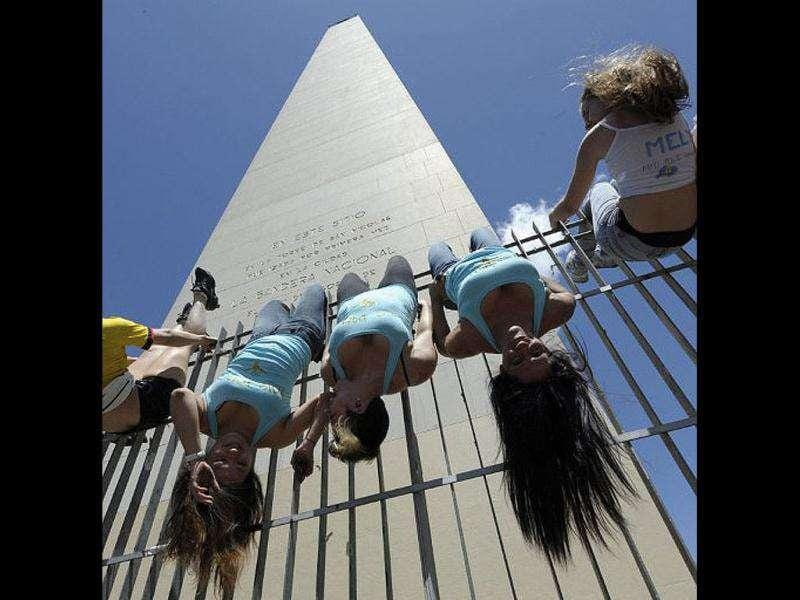 South American participants to the Miss Pole Dance Argentina 2011 and Miss Pole Dance South America 2011 competitions perform in front of the Obelisk in downtown Buenos Aires.