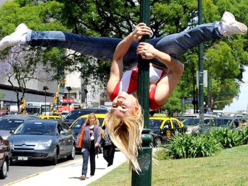 Paraguayan competitor to the Miss Pole Dance Argentina 2011 and Miss Pole Dance South America 2011 competition performs at Plaza de la Republica square in downtown Buenos Aires.