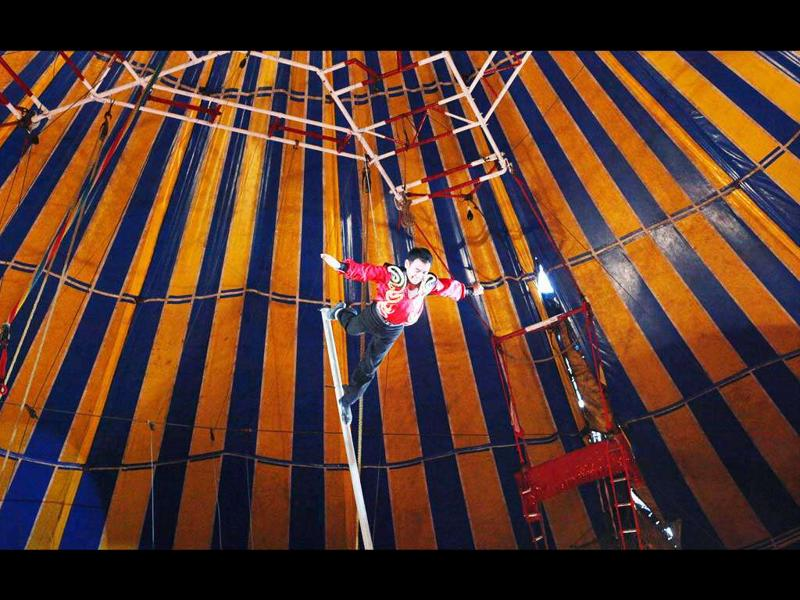 An acrobat performs during a show at the Rambo Circus in Mumbai.
