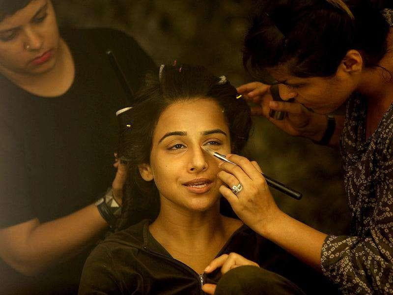 Behind the scenes: Vidya gets ready to rock as the makeup artists work their magic on her. (HT Brunch)