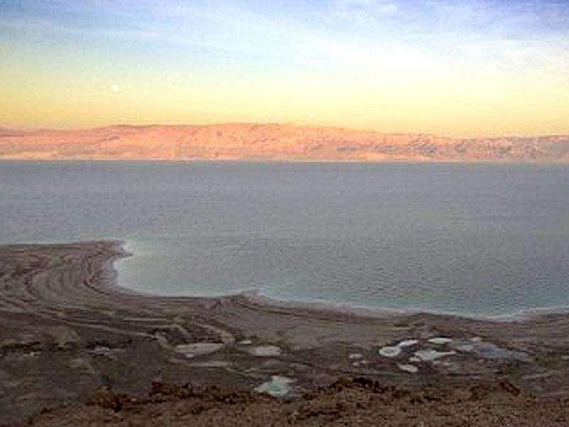 A picture shows the Israeli (bottom) and Jordanian (top) shores of the Dead Sea. The Dead Sea may soon shrink to a lifeless pond as Middle East political strife blocks vital measures needed to halt the decay of the world's lowest and saltiest body of water, experts say. AFP Photo/Jack Guez