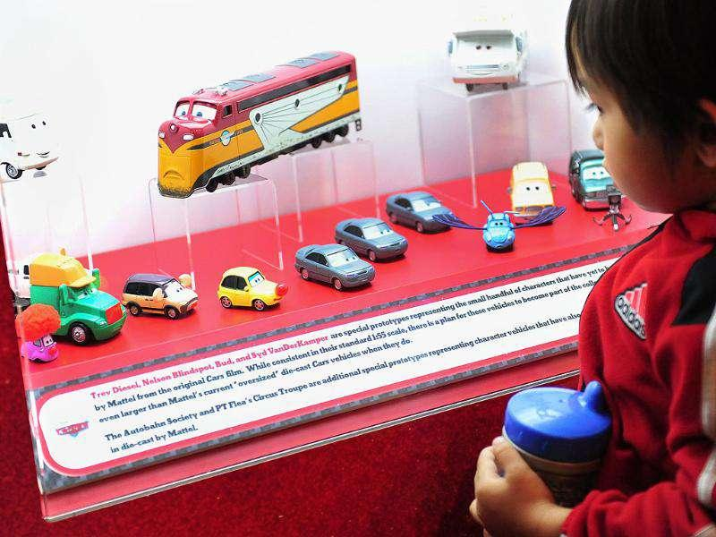 A child views a special collection never released to the general public of Mattel die-cast vehicles from the Disney-Pixar film Cars at an exhibition in the Petersen Automotive Museum in Los Angeles. (Photo: AFP)