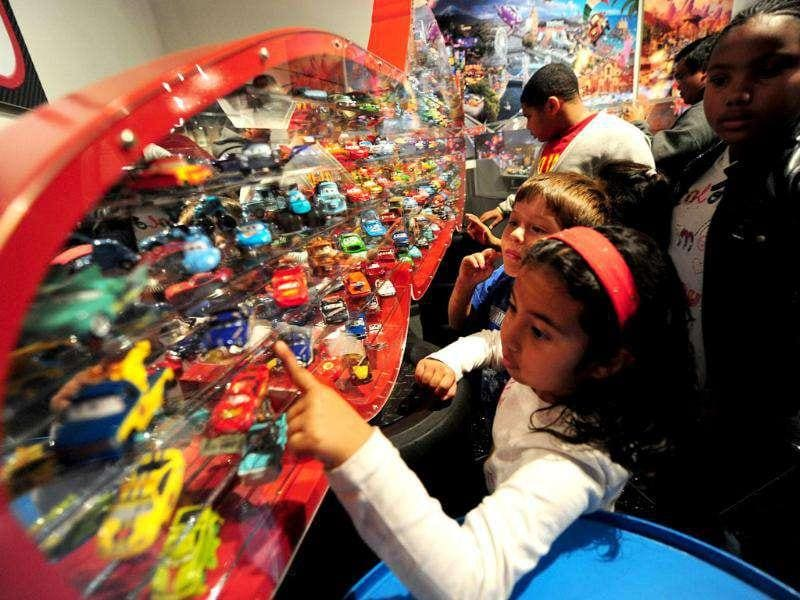Children look at a collection of Mattel die-cast vehicles from the Disney-Pixar film Cars at an exhibition in Los Angeles. (Photo: AFP)