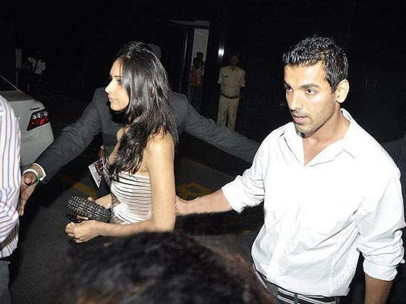 Caught ya! John Abraham is snapped holding Priya's arm. Or is it a camera trick?