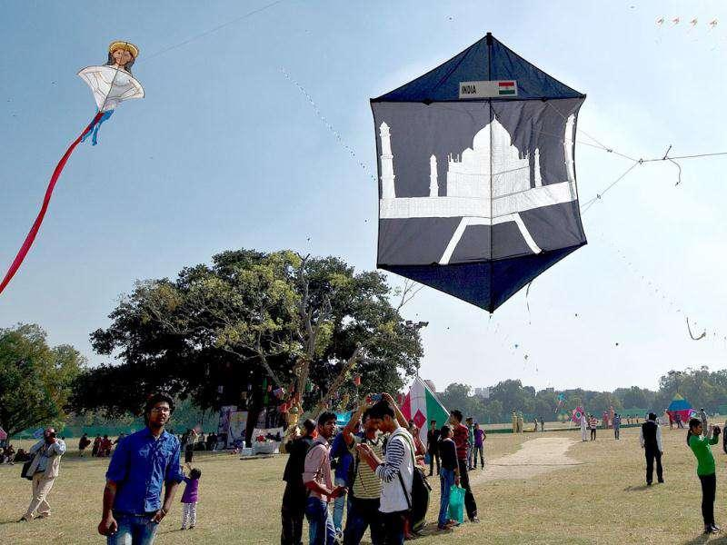 A kite-flyer flies a kite portraying the Taj Mahal monument during a kite-flying festival on the lawns of the India Gate monument in New Delhi. . (AFP Photo/ Manan Vatsyayana)