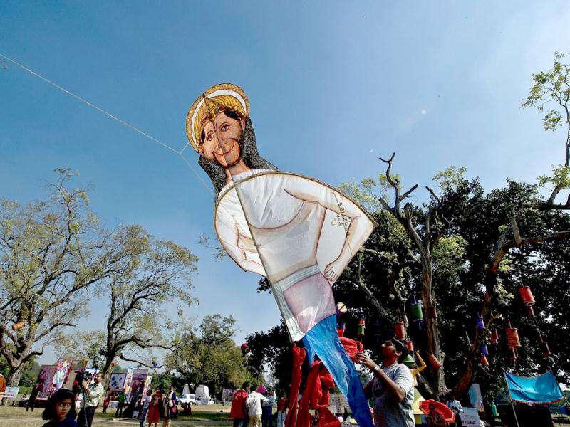 A kite-flyer prepares to fly a kite in the shape of Hindu god Hanuman during a kite-flying festival at the India Gate monument lawns in New Delhi. (AFP Photo/ Manan Vatsyayana)