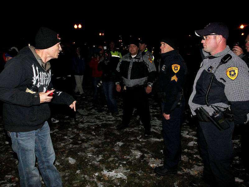 Occupy Salt Lake City protestor, Jason Wilcox, pleads to police officers not to shut down their encampment. (AP Photo/Colin E. Braley)