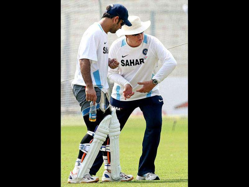 Indian Captain MS Dhoni gets tips from coach Duncan Fletcher during their training session at Eden Garden in Kolkata on the eve of 2nd Test match against West Indies.