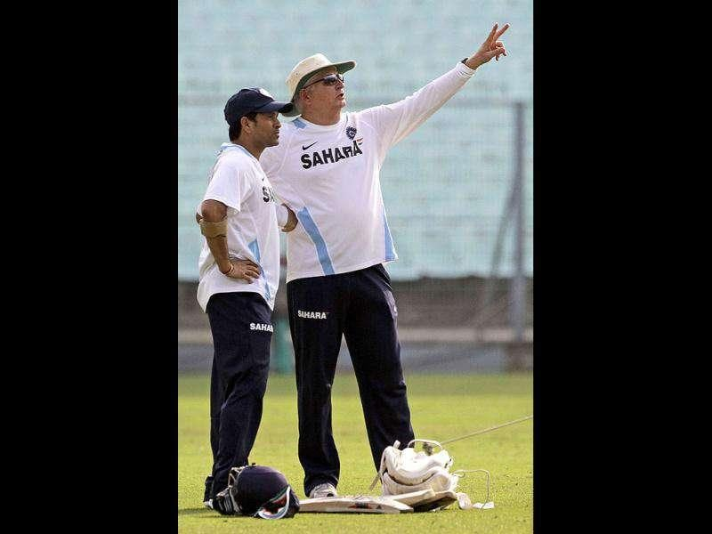 Indian cricket coach Duncan Fletcher, right, interacts with cricketer Sachin Tendulkar during a practice session ahead of the 2nd Test cricket match against West Indies.