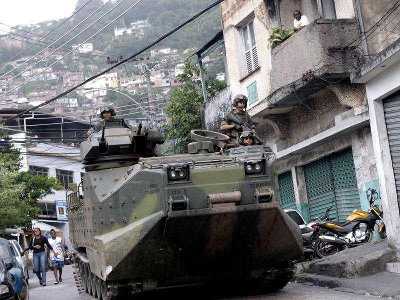 Brazilian Navy soldiers patrol the Vidigal slum during the