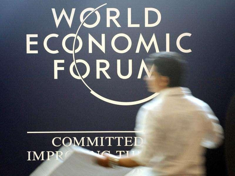 A support staff sets up a television camera at the World Economic Forum - India Economic Summit in Mumbai.