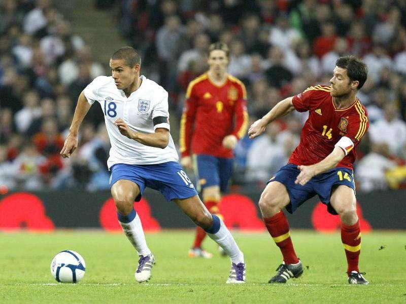 England's Jack Rodwell, left, competes for the ball with Spain's Xabier Alonso during the international friendly soccer match between England and Spain at Wembley Stadium in London.