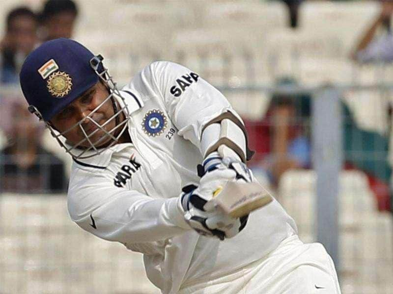 Virender Sehwag plays a shot on the first day of their second Test cricket match against West Indies in Kolkata.
