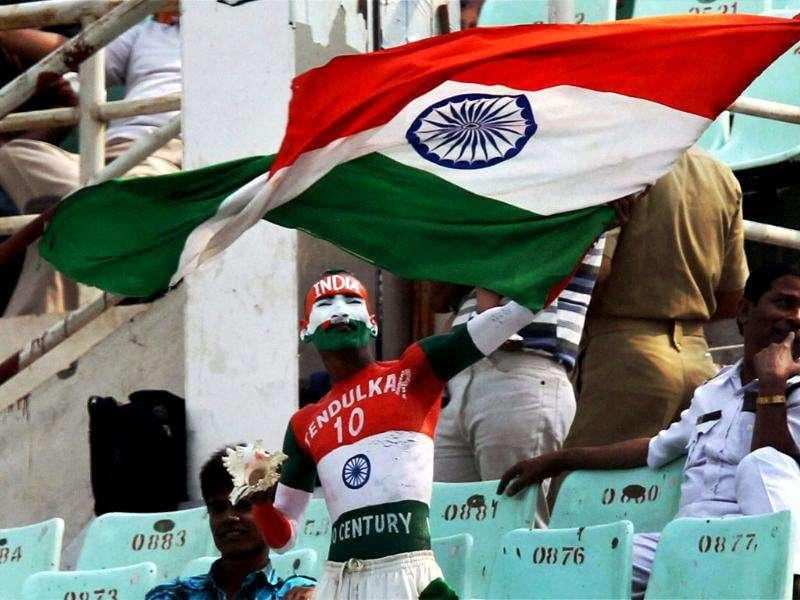 A Sachin Tendulkar fan waves the Tri-colour at Eden Gardens in Kolkata.