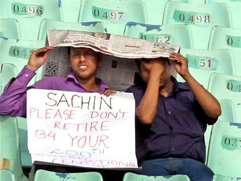 Indian supporters watch first day's play of the 2nd Test Match against West Indies at Eden Gardens in Kolkata.