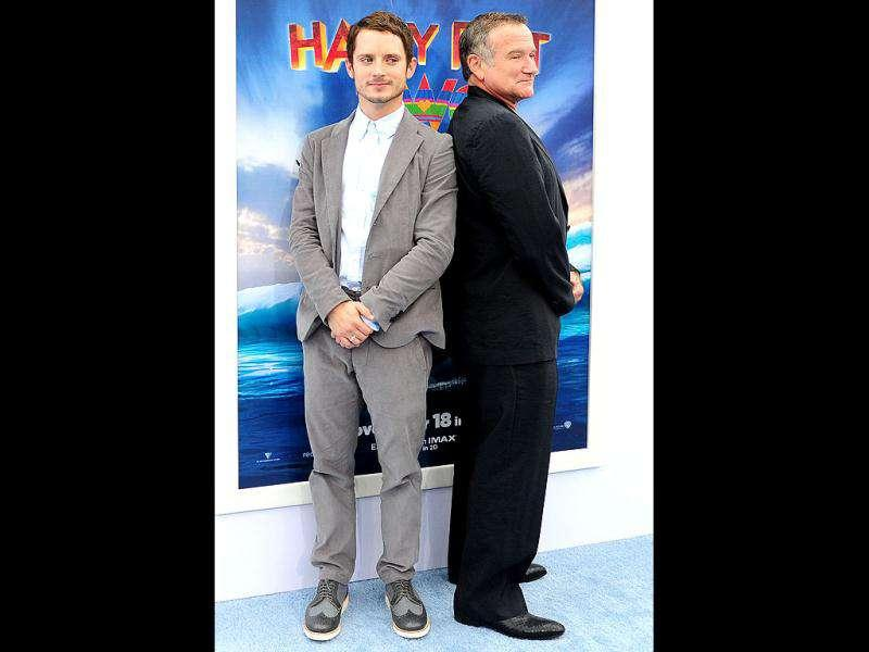 Posing a serious look, Elijah Wood and Robin Williams.