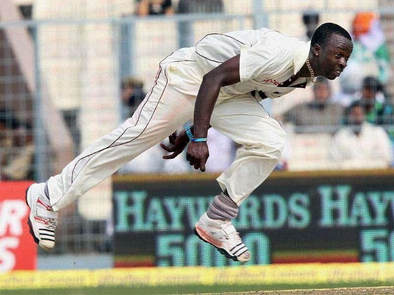 West Indies bowler Kemar Roach in action during 1st day of 2nd Test match at Eden Gardens in Kolkata.