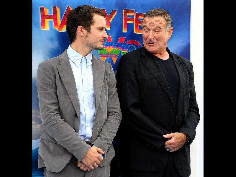 Actors Elijah Wood and Robin Williams pose at the event.