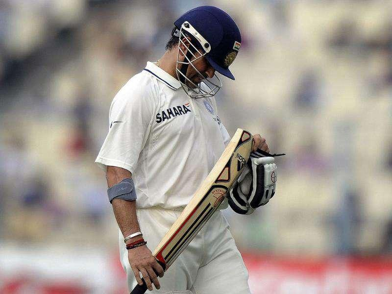 Sachin Tendulkar looks at his bat after losing his wicket during the first day of the second Test cricket match between India and West Indies at The Eden Gardens in Kolkata.