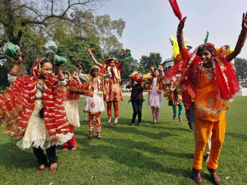 Children participate in a traditional dance to celebrate the nation's first Prime Minister Jawahar Lal Nehru's birth anniversary at his ancestral home, Anand Bhawan in Allahabad.
