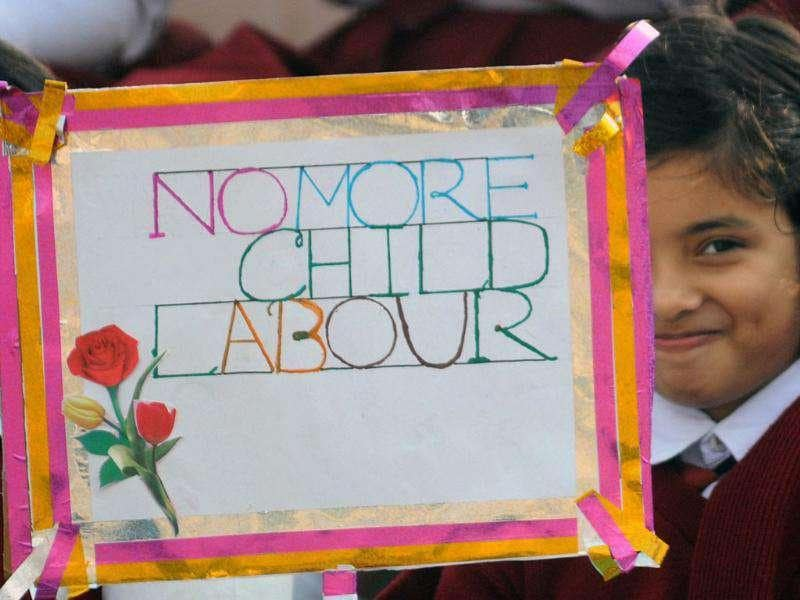 Children hold placards at a function on the occasion of Children's Day in Agartala.