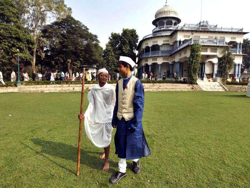 School children dressed as Mahatma Gandhi, left, and India's first Prime Minister Jawahar Lal Nehru walk during Nehru's birth anniversary at his ancestral home, Anand Bhawan in Allahabad.