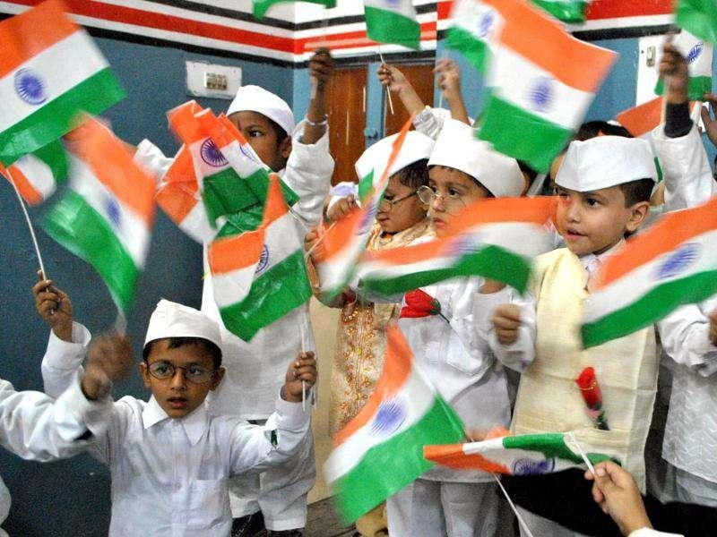 School children hold Indian flags during a tribute-paying ceremony to Pandit Jawaharlal Nehru on his birth anniversary observed as Children's Day in Amritsar.