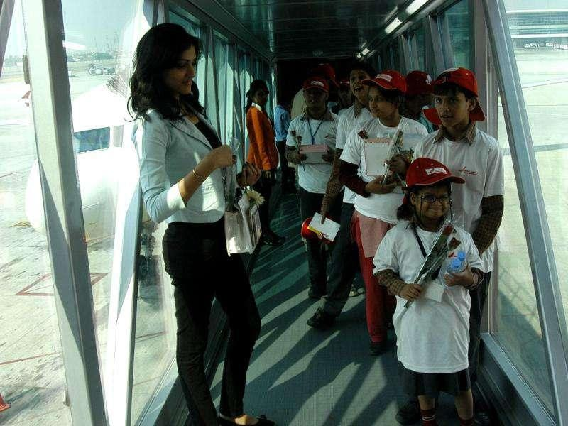 Special children on their arrival at IGI airport after their air journey from Lucknow to Delhi, organised by Air India on the occasion of Children's Day.