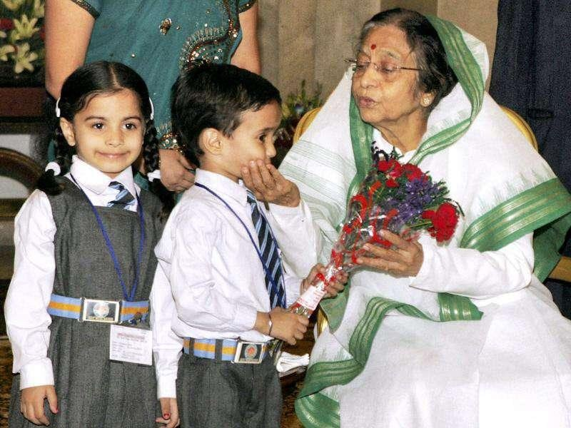 President Pratibha Devisingh Patil meets children from various sections of society on the occasion of Children's Day at Rashtrapati Bhavan in New Delhi.