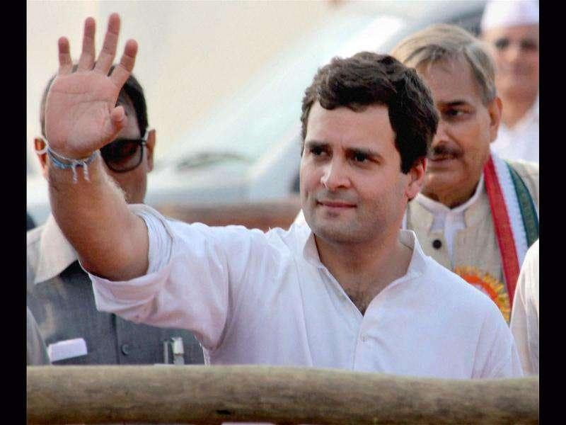 AICC general secretary Rahul Gandhi waves at the crowd at a party rally in Phulpur near Allahabad.
