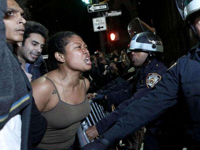 A demonstrator yells at police officers as they order Occupy Wall Street protesters to leave Zuccotti Park, their longtime encampment in New York.
